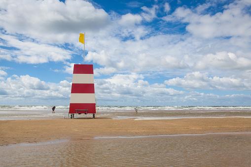 Lighthouse on the amazing Lakolk beach after heavy rain.