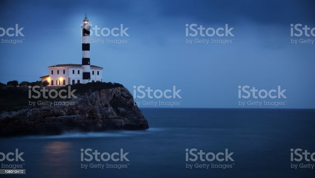 Lighthouse on the Cliff by Blue Twilight royalty-free stock photo