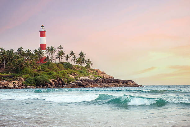 Lighthouse on the cliff in Kovalam Beach stock photo