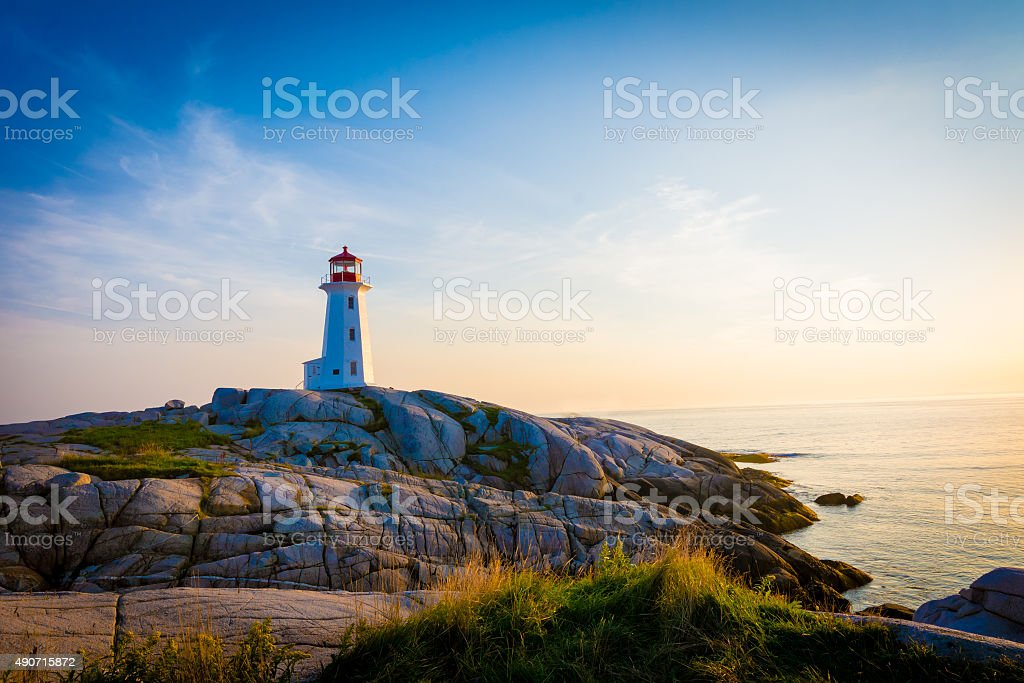 Lighthouse on the coastline. stock photo