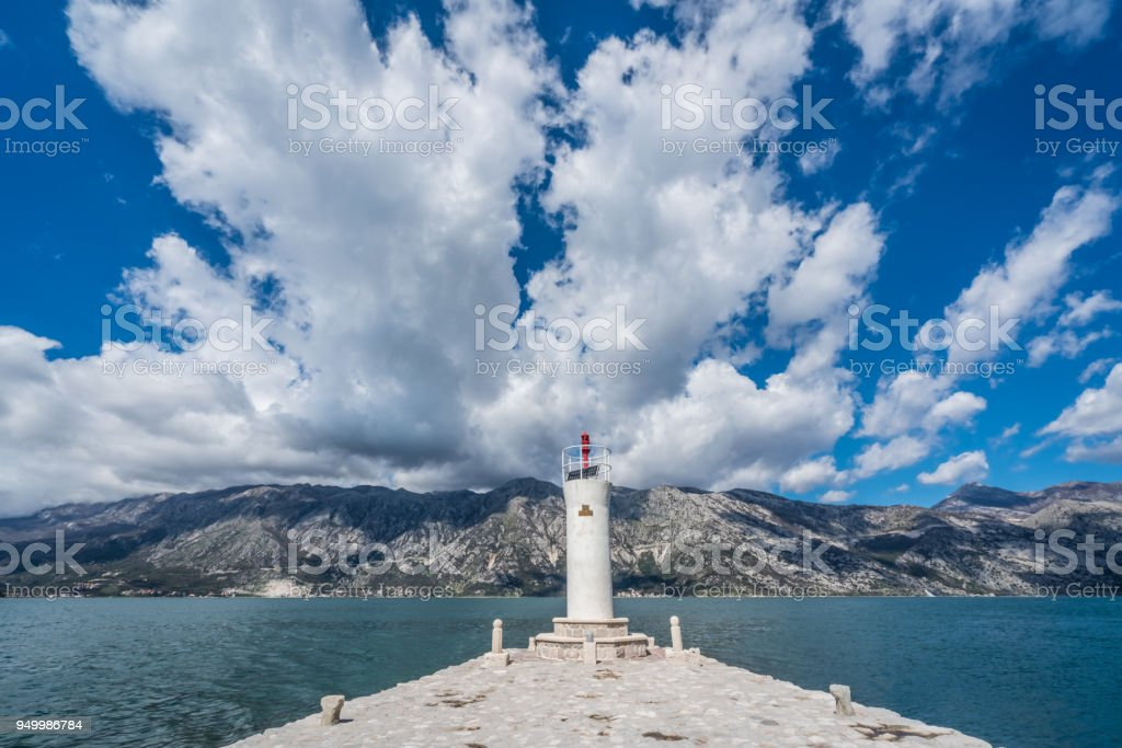 Lighthouse on the  island of Our Lady on the Rock stock photo