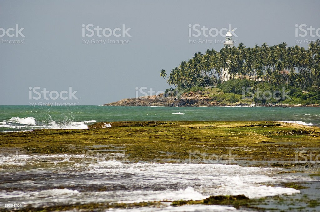 Lighthouse on the island royalty-free stock photo