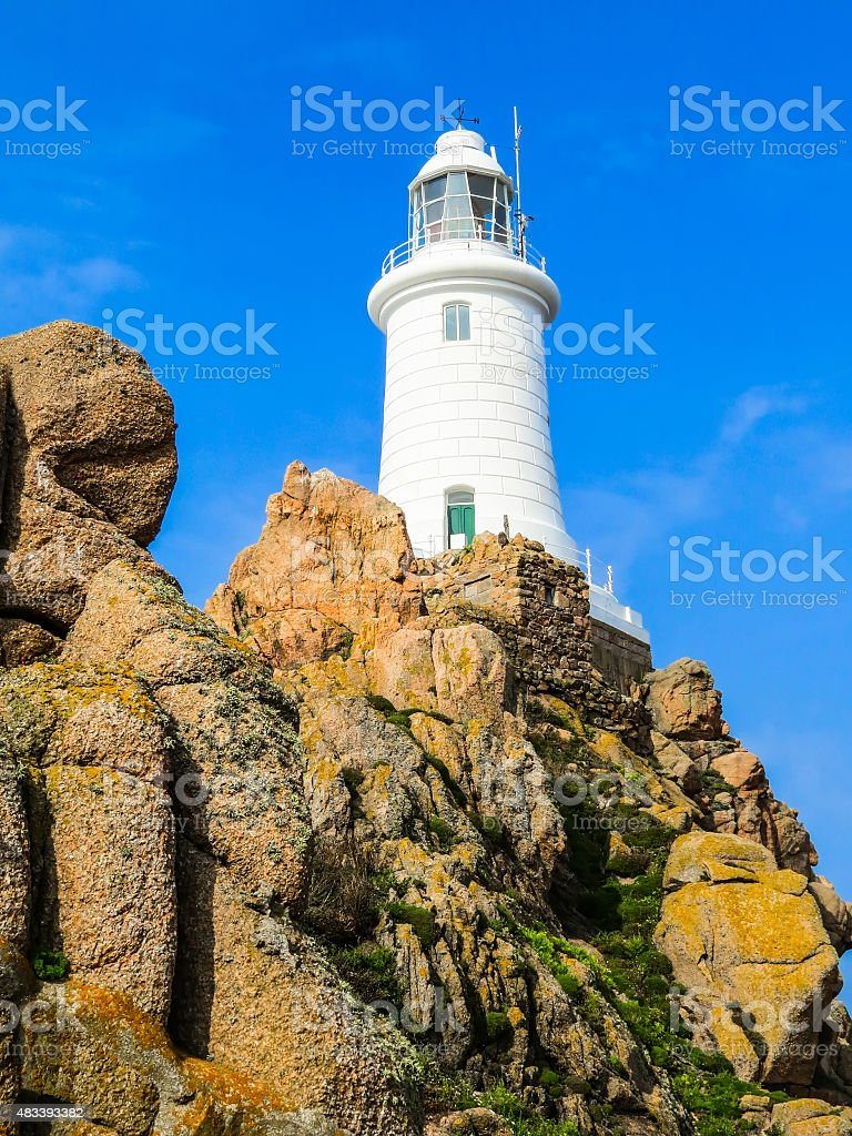 Lighthouse on the rock. Jersey Island, Channel Islands, England stock photo