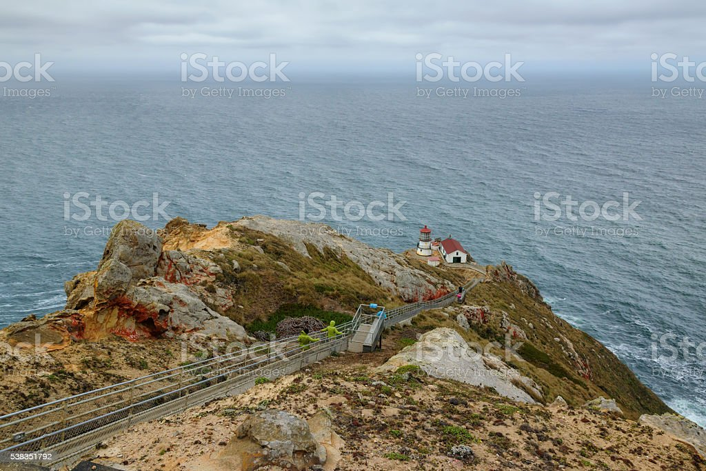 Lighthouse on the rock stock photo