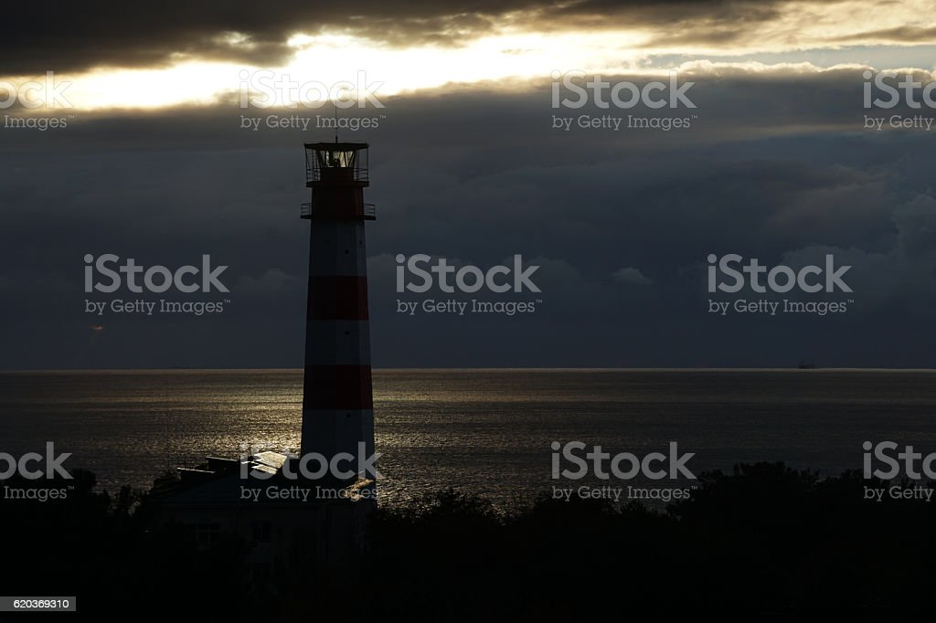 Lighthouse on the sea under stormy clouds and with the zbiór zdjęć royalty-free