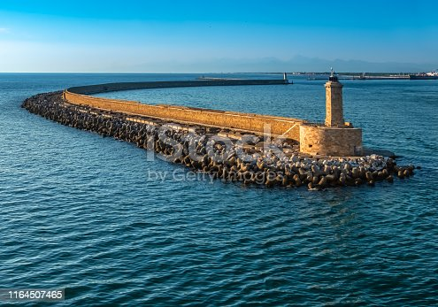 Lighthouse at the harbour, Livorno, Italy.