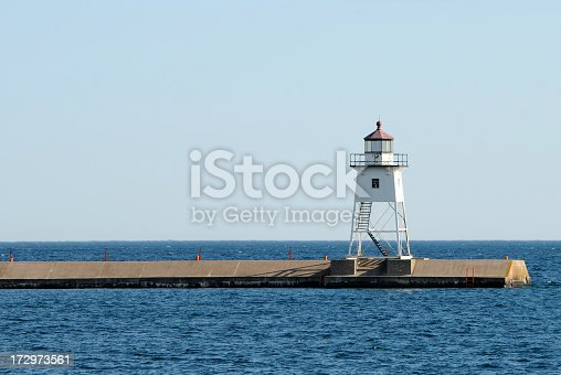Lighthouse of Grand Marais harbor with a view on the Lake Superior. Northern Minnesota, USA.