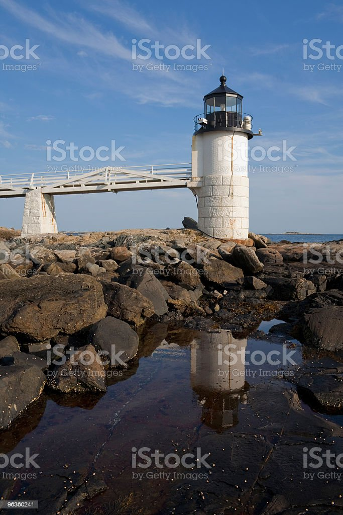 Lighthouse reflecting in tidal pool royalty-free stock photo