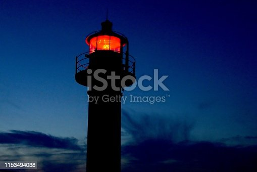 615497916 istock photo Lighthouse shining in the dark.Beautiful 1153494038