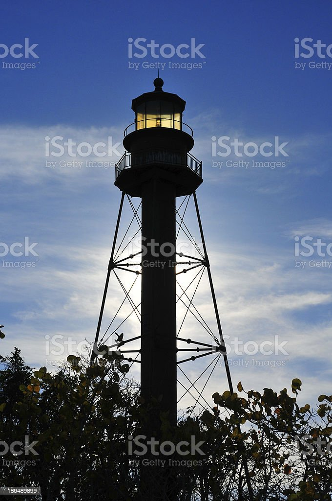 Lighthouse silhouette against the sky stock photo