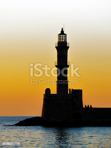 615497916 istock photo Lighthouse silhouette at sunset. 826601716