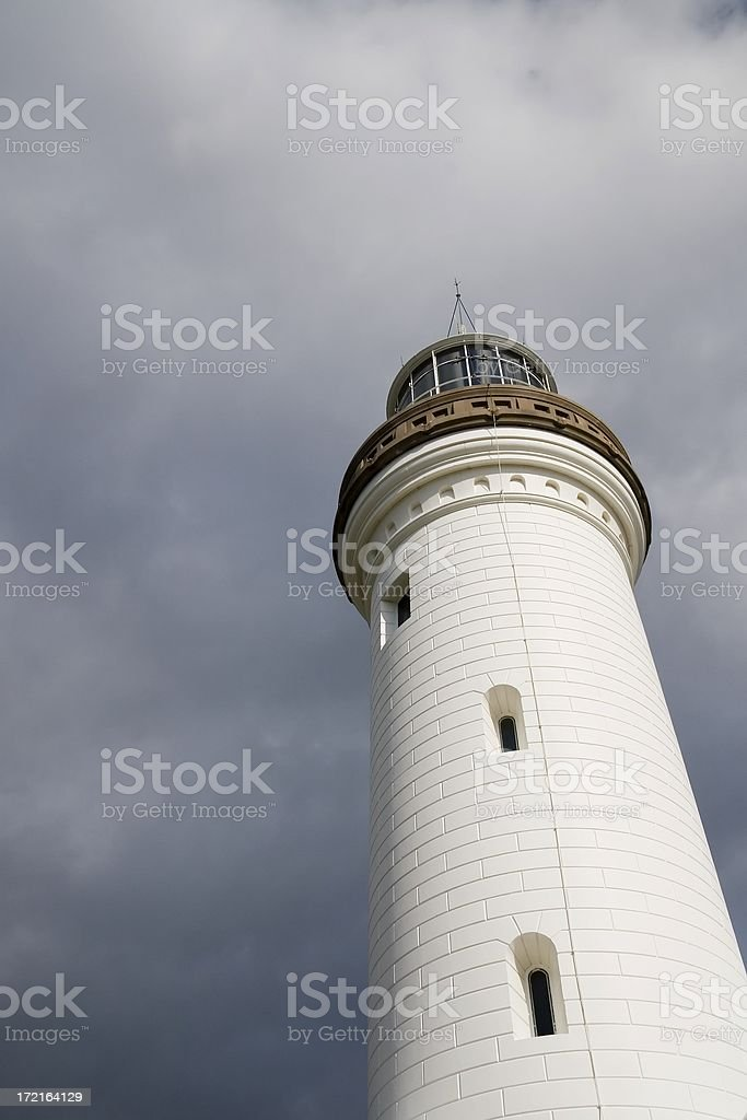 Lighthouse stormy sky royalty-free stock photo