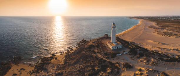 灯台サンセット - アンダルシア州 ストックフォトと画像