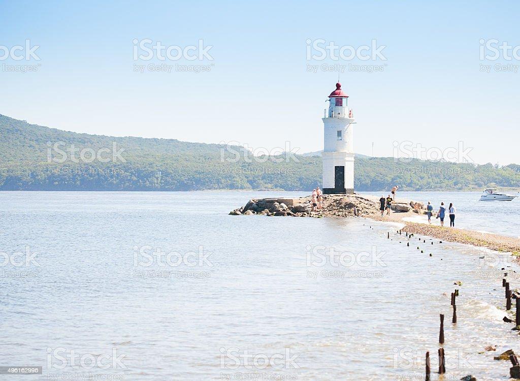 Lighthouse Tokarevskaya koshka with vane anemometer in Vladivost stock photo
