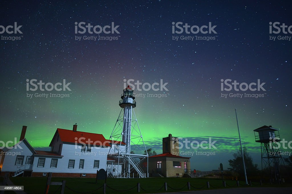 Lighthouse under Aurora lights, Michigan, USA stock photo