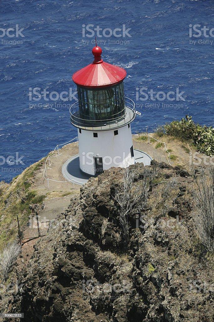 Faro con un techo rojo. foto de stock libre de derechos
