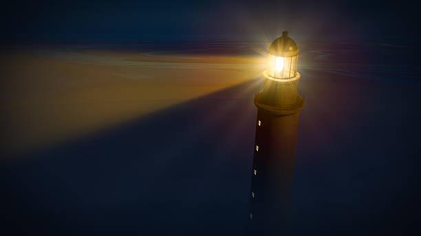 Lighthouse with beam of shining light stock photo