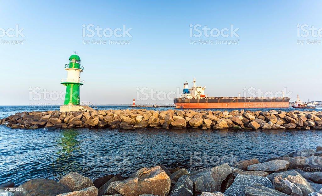 Lighthouse with big ship in Warnemünde