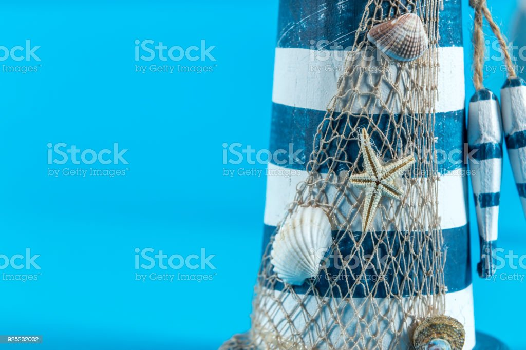 Lighthouse with life buoy stock photo