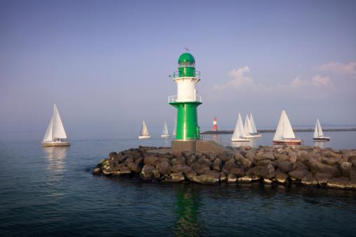 lighthouse with many sailboats / Warnemünde, Germany