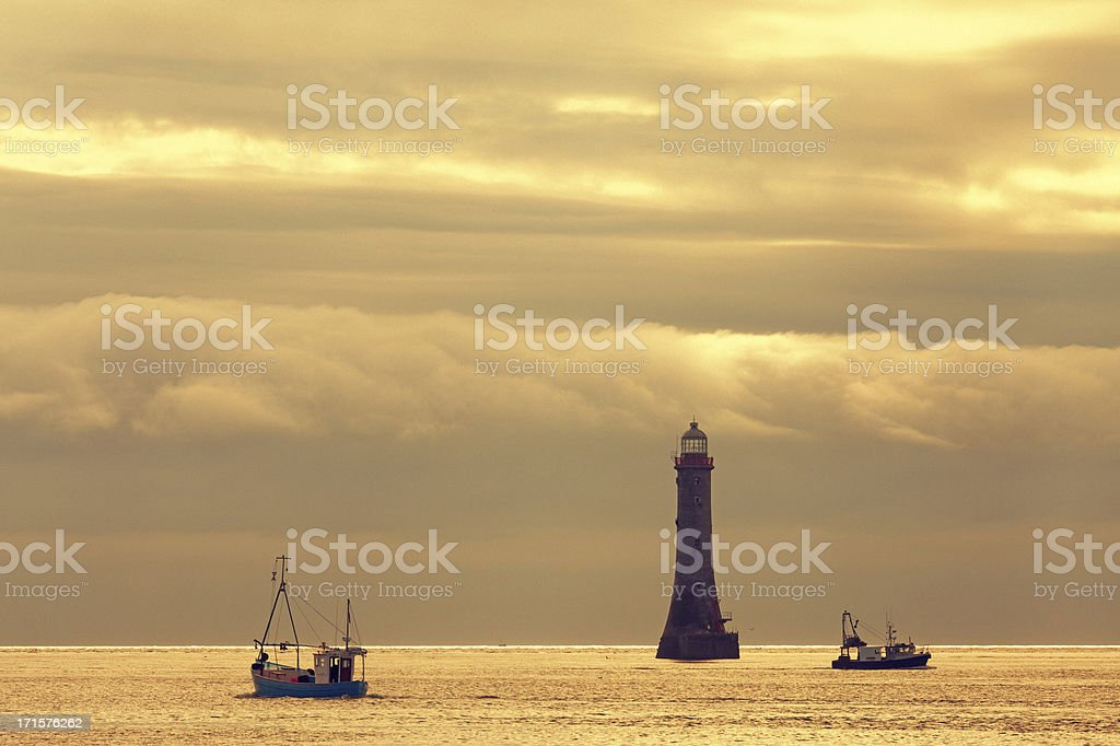 lighthouse with ships stock photo