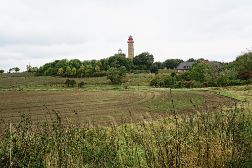 lighthouse with small store at Cape Arkona. Autumn stormy weathe