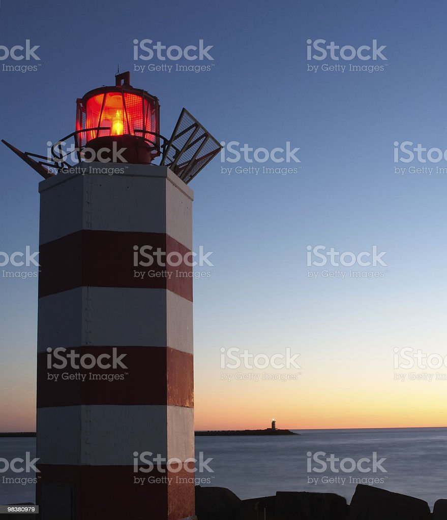 Lighthouses at dusk royalty-free stock photo