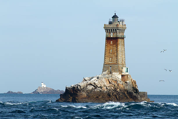 lighthouses in ocean stock photo