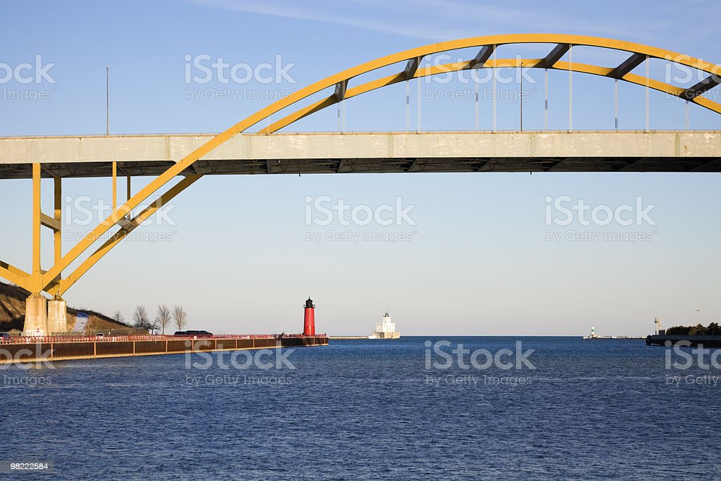 Lighthouses under the bridge royalty-free stock photo