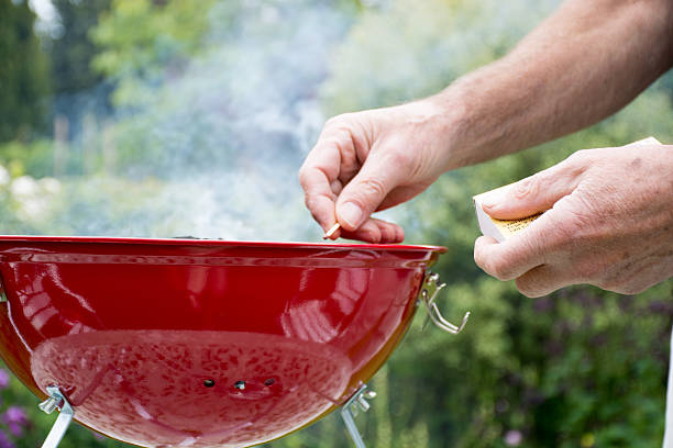 Lighting a BBQ with a match stock photo