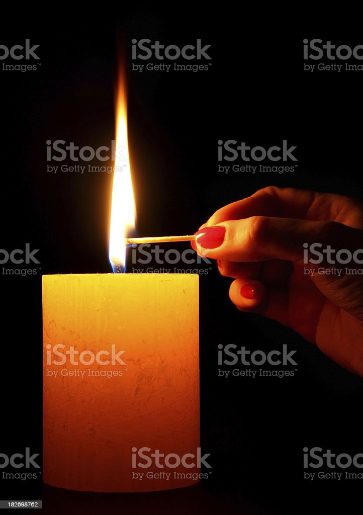 Lighting a candle royalty-free stock photo