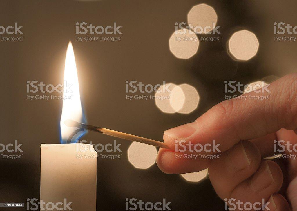 LIghting a candle - Royaltyfri Antända Bildbanksbilder