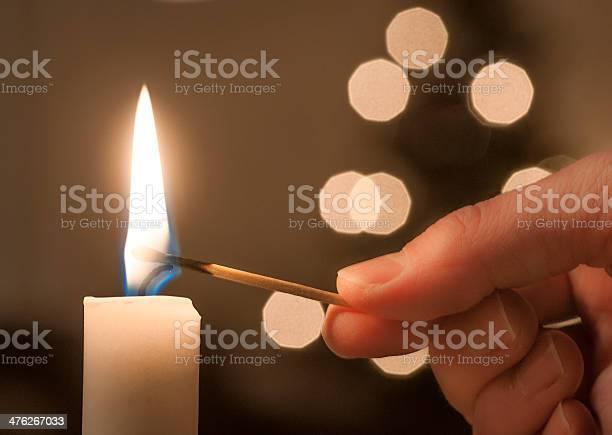 Lighting A Candle-foton och fler bilder på Antända