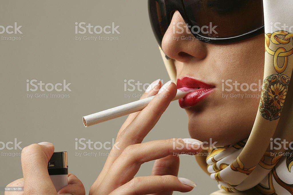 Lighting a cigarette stock photo