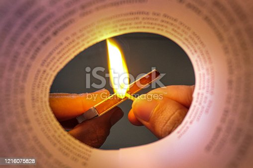 Lighting a match with a paper frame