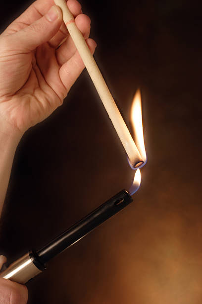 lighting an ear  candle - hopi stock photos and pictures