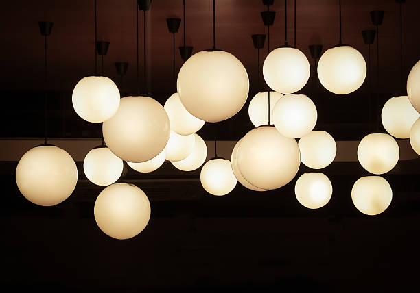 lighting ball hanging from the ceiling - deckenlicht stock-fotos und bilder