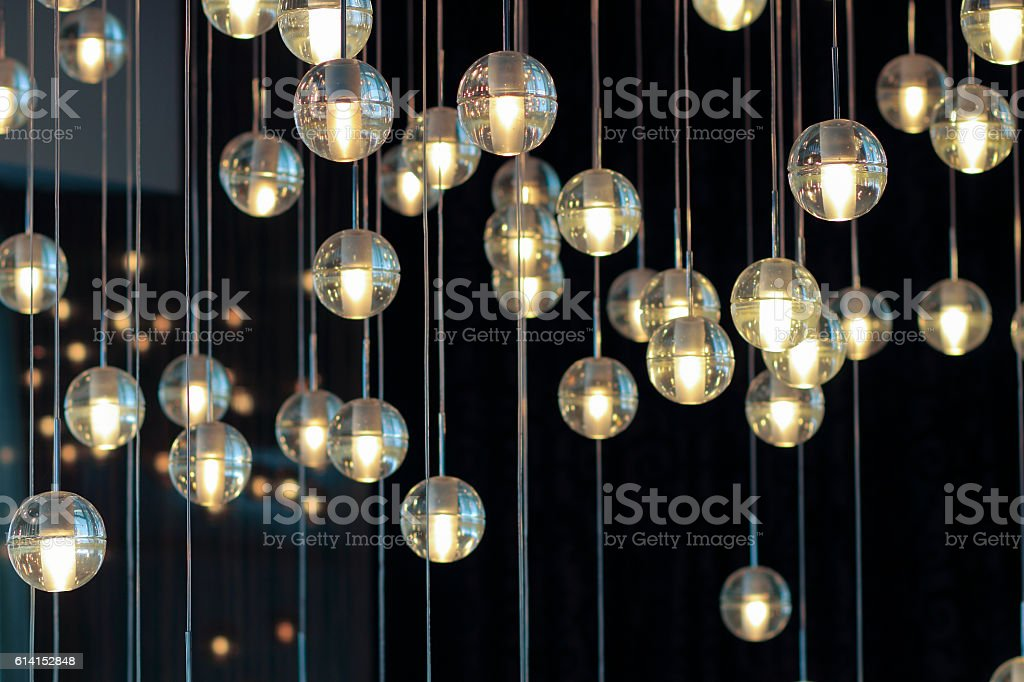 lighting balls on the chandelier in the lamplight stock photo