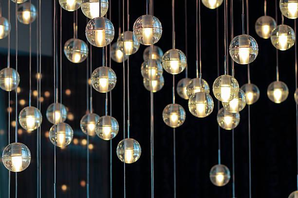 lighting balls on the chandelier in the lamplight - żyrandol sprzęt oświetleniowy zdjęcia i obrazy z banku zdjęć