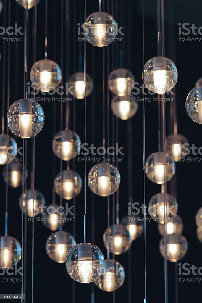 lighting balls on the chandelier in the lamplight – Foto