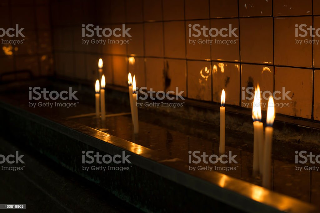 Lighting Candle in  ceremnony stock photo