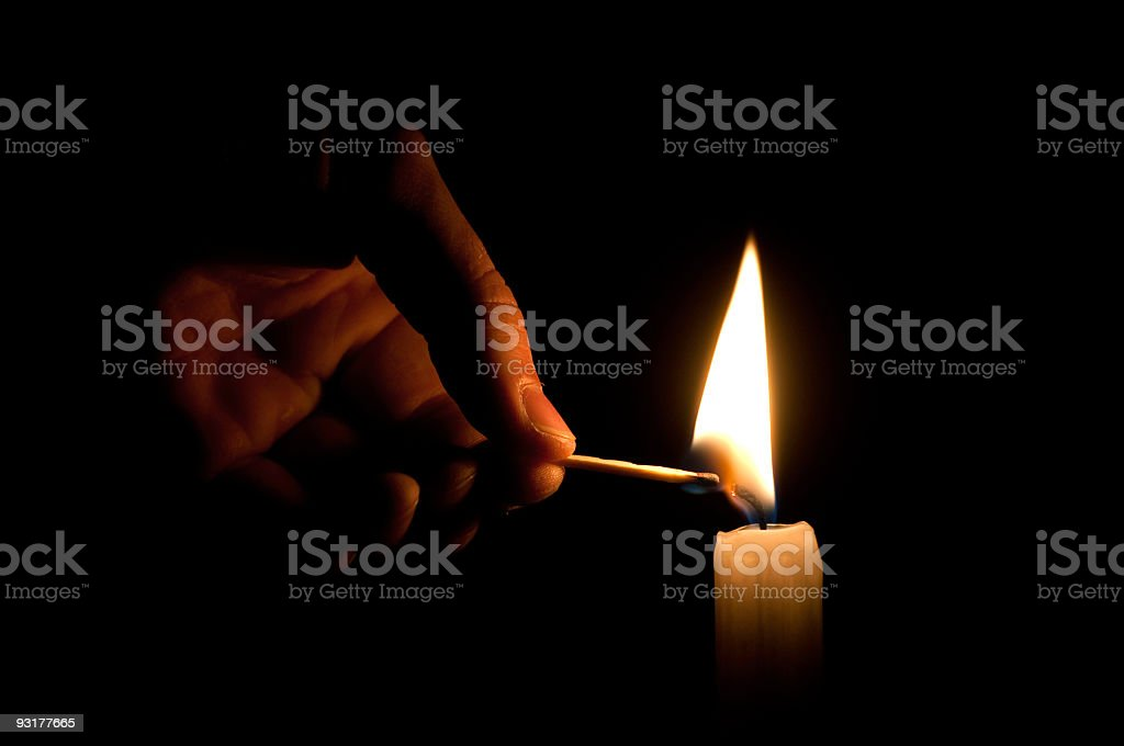 Lighting candle royalty-free stock photo