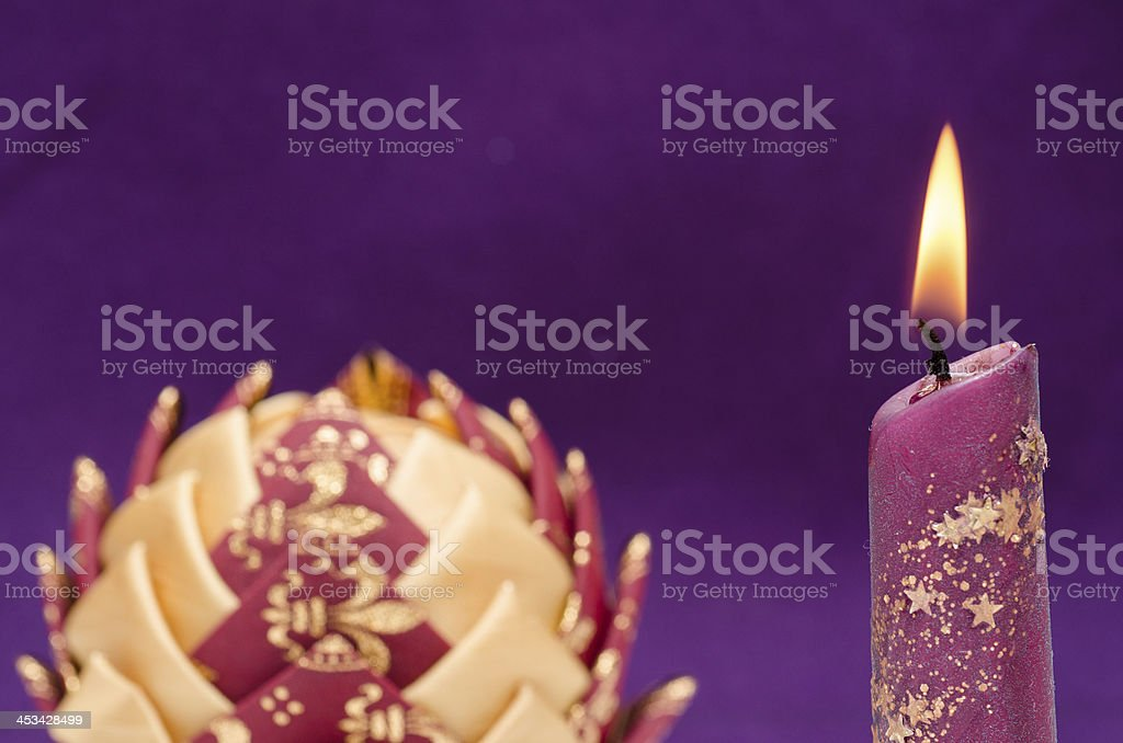 Lighting candle with christmas bubble stock photo