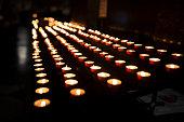 Lighting candles at church