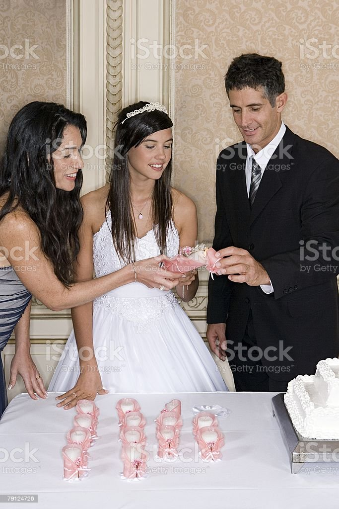 Lighting candles for quinceanera royalty-free 스톡 사진