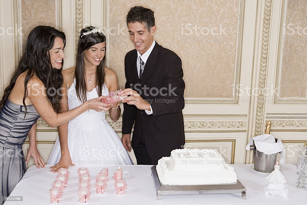 Lighting candles for quinceanera stock photo