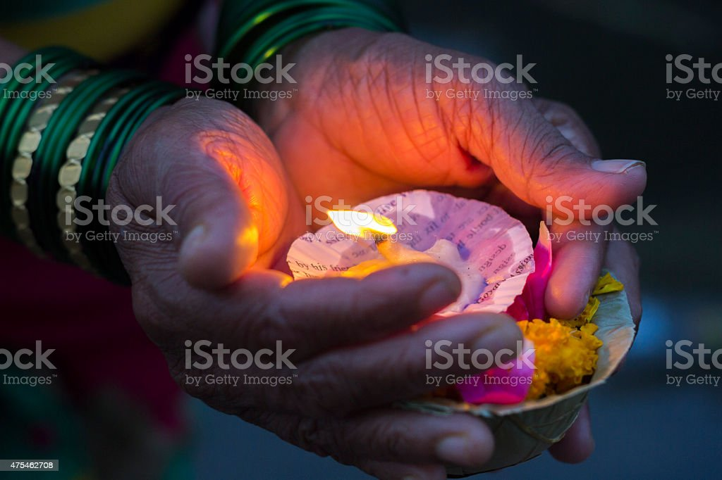 Lighting diyas as offerings to the Ganga River stock photo