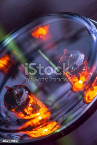 istock Lighting Electronic Tubes behind glass 484065063