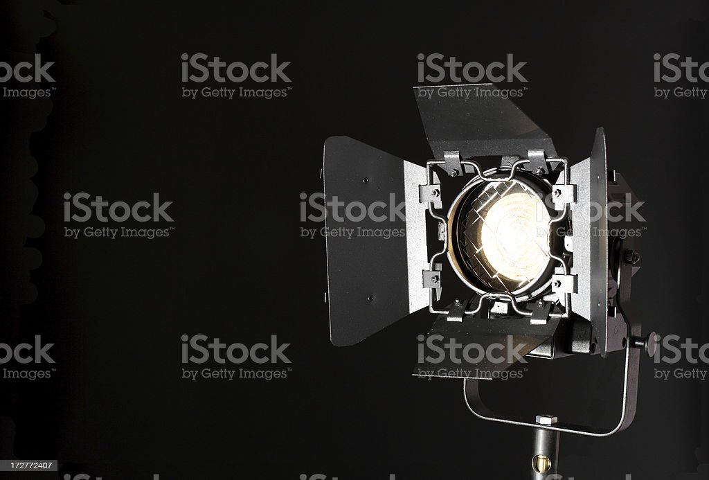Lighting equipment in action. Isolated on black.See moreaA 