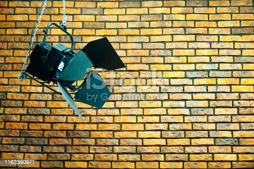lighting film on the background of a brick yellow wall, background